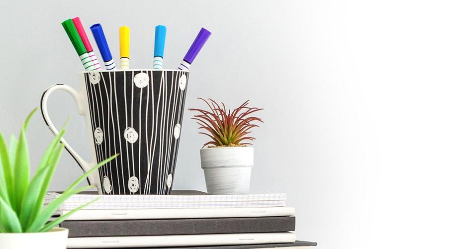 Image iwth cup of pens - blackbird Design